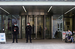 © Licensed to London News Pictures. 02/03/2021. LONDON, UK.  City of London police officers stand guard outside St Bartholomew's hospital where the Duke of Edinburgh was transferred to from King Edward VII hospital yesterday. Buckingham Palace has said doctors will continue to treat him for an infection and a pre-existing heart condition.  St Bartholomew's is a centre of excellence in cardiac care and has Europe's largest specialised cardiovascular centre.  Photo credit: Stephen Chung/LNP