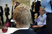 School and college leavers listen to seminar given by an accountancy lecturer at a company's London headquarters