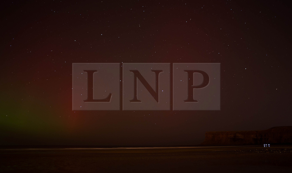 © Licensed to London News Pictures. 27/02/2014<br /> <br /> Saltburn, England<br /> <br /> The Aurora Borealis is visible over the area known as Huntcliff in Saltburn by the Sea, Cleveland.<br /> <br /> Photo credit : Ian Forsyth/LNP