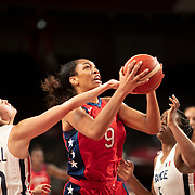 TOKYO, JAPAN August 2:  A'Ja Wilson #9 of the United States drives to the basket defended by Sarah Michel #10 of France during the France V USA Preliminary Round Group B Basketball Women match at the Saitama Super Arena during the Tokyo 2020 Summer Olympic Games on August 2, 2021 in Tokyo, Japan. (Photo by Tim Clayton/Corbis via Getty Images)