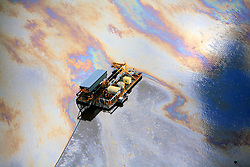 CANADA ALBERTA FORT MCMURRAY 20JUL09 - Aerial view of oily surface of the Mildred Lake tailings pond adjacent to the Syncrude upgrader north of Fort McMurray, northern Alberta, Canada...The tar sand deposits lie under 141,000 square kilometres of sparsely populated boreal forest and muskeg and contain about 1.7 trillion barrels of bitumen in-place, comparable in magnitude to the world's total proven reserves of conventional petroleum. Current projections state that production will  grow from 1.2 million barrels per day (190,000 m³/d) in 2008 to 3.3 million barrels per day (520,000 m³/d) in 2020 which would place Canada among the four or five largest oil-producing countries in the world...The industry has brought wealth and an economic boom to the region but also created an environmental disaster downstream from the Athabasca river, polluting the lakes where water and fish are contaminated. The native Indian tribes of the Mikisew, Cree, Dene and other smaller First Nations are seeing their natural habitat destroyed and are largely powerless to stop or slow down the rapid expansion of the oil sands development, Canada's number one economic driver...jre/Photo by Jiri Rezac / GREENPEACE..© Jiri Rezac 2009