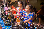 13 APRIL 2013 - BANGKOK, THAILAND:  People bathe statues of the Buddha with scented oils on Songkran in Bangkok. Songkran is the traditional Thai New Year's Festival. It is held April 13-16. Many Thais mark the holiday by going to temples and making merit by giving extra alms to monks or offering extra prayers. They also mark Songkran with joyous water fights. Songkran has been a national holiday since 1940, when Thailand moved the first day of the year to January 1.   PHOTO BY JACK KURTZ