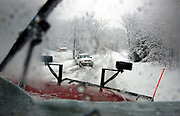 A truck is stopped on Mount Tabor Road Sunday morning, as a Monroe County Highway Department plow clears snow near Ellettsville. (Photo by Jeremy Hogan)