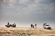 Rebel army volunteers prepare for a battle with Qadaffi loylaists In Braga on March 3, 2011.