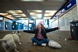 © Licensed to London News Pictures. 25/12/2020. Manchester, UK. Homeless couple Nathan Dale (25 - not pictured) and AMY DEWHURST (26) and their dog APACHE , on Market Street in Manchester City Centre on Christmas Day . Photo credit: Joel Goodman/LNP