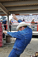 A bareback rider simulates his experience as he waits for his chance on Saturday at the 2013 California Rodeo Salinas.