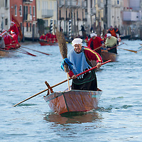 "VENICE, ITALY - JANUARY 06:  Rowers dressed in costume race along the Grand Canal for the ""Befana"" Regatta on January 6, 2014 in Venice, Italy. In Italian folklore, Befana is an old woman who delivers gifts to children throughout Italy on the feast of the Epiphany on January 6 in a similar way to Saint Nicholas or Santa Claus.  (Photo by Marco Secchi/Getty Images)"