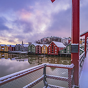 www.aziznasutiphotography.com                                          Picture has been taken in a calm and beautiful March sunrise over the famous Trondheim's wooden houses in Norway. From Gamle bybro or old town bridge.