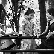 This girl seems to be the center of the conversation; she is looking down while her friends are laughing. Is she blushing? A good-natured atmosphere emerges from this picture...