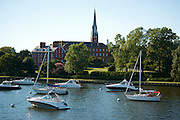 Sailboats moored along the Annapolis waterfront with the historic Charles Carroll house and St. Mary's Church in the skyline. Charles Carroll of Carrollton secured his family¹s vision of personal, political and religious freedoms for all citizens when he became the only Catholic to sign the Declaration of Independence in 1776.....Maryland is now the only state in America in which the homes of all of its signers of the Declaration of Independence still exist and all are located in Annapolis. The Carroll House is one of only fifteen surviving signers' birthplaces in the United States.