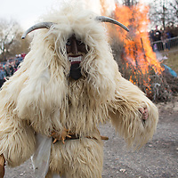 Local people in traditional buso dresses light bonfires as the celebrate the Buso Carnival in Mohacs (about 200 km South from capital city Budapest), Hungary on February 07, 2016. ATTILA VOLGYI
