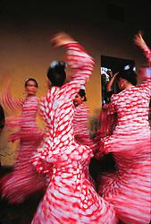 Europe, Spain, Andalucia, Sevilla, flamenco dancers in pink dresses (blurred motion)