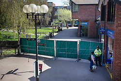 © Licensed to London News Pictures. 20/04/2018. Salisbury, UK. A shopper (R) talks to a police officer next to new barriers erected in the Maltings shopping area as a cleanup operation begins in Salisbury. Former Russian Spy Sergei Skripal and his daughter Yulia were poisoned using a nerve agent in the city lady month. Experts have warned that 'Toxic levels' of the nerve agent novichok could still be present at hot spots around the city. Photo credit: Peter Macdiarmid/LNP
