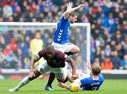 Hearts' Uche Ikpeazu (front left) and Rangers Joe Worrall battle for the ball during the Ladbrokes Scottish Premiership match at Ibrox Stadium, Glasgow.