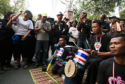 © Licensed to London News Pictures. 05/01/2014. A group of Anti-Government protestors dance as a makeshift band plays traditional Thai songs during the third day of the 'Bangkok Shutdown' as anti-government protesters continue with their 'shutdown' of Bangkok.  Major intersections in the heart of the city have been blocked in their campaign to oust Prime Minister Yingluck Shinawatra and her government in Bangkok, Thailand. Photo credit : Asanka Brendon Ratnayake/LNP