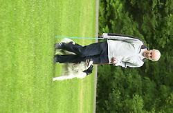 Eddie Sander with his Dogs Jackson and Inka<br /><br />18 June 2004<br /><br />Copyright Paul David Drabble<br /> [#Beginning of Shooting Data Section]<br />Nikon D1 <br /> Focal Length: 145mm<br /> Optimize Image: <br /> Color Mode: <br /> Noise Reduction: <br /> 2004/06/18 09:13:48.5<br /> Exposure Mode: Programmed Auto<br /> White Balance: Auto<br /> Tone Comp: Normal<br /> JPEG (8-bit) Fine<br /> Metering Mode: Multi-Pattern<br /> AF Mode: AF-S<br /> Hue Adjustment: <br /> Image Size:  2000 x 1312<br /> 1/125 sec - F/5.6<br /> Flash Sync Mode: Not Attached<br /> Saturation: <br /> Color<br /> Exposure Comp.: 0 EV<br /> Sharpening: Normal<br /> Lens: 80-200mm F/2.8<br /> Sensitivity: ISO 200<br /> Image Comment: <br /> [#End of Shooting Data Section]