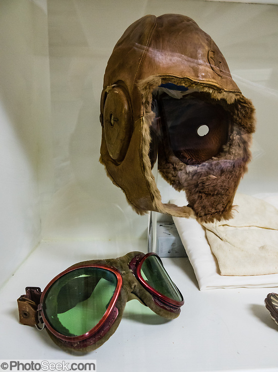 """Japanese kamakaze pilot headgear & goggles, USS Missouri museum, Pearl Harbor, Oahu, Hawaii, USA. Ordered in 1940 and active in June 1944, the USS Missouri (""""Mighty Mo"""") was the last battleship commissioned by the United States. She is best remembered as the site of the surrender of the Empire of Japan which ended World War II on September 2, 1945 in Tokyo Bay. In the Pacific Theater of World War II, she fought in the battles of Iwo Jima and Okinawa and shelled the Japanese home islands. She fought in the Korean War from 1950 to 1953. Decommissioned in 1955 into the United States Navy reserve fleets (the """"Mothball Fleet""""), she was reactivated and modernized in 1984 and provided fire support during Operation Desert Storm in January-February 1991. The ship was decommissioned in March 1992. In 1998, she was donated to the USS Missouri Memorial Association and became a museum at Pearl Harbor."""