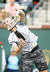 March 10, 2019 - Indian Wells, CA, U.S. - INDIAN WELLS, CA - MARCH 10: Adrian Mannarino (FRA) hits a serve during the second round of the BNP Paribas Open on March 10, 2019, at the Indian Wells Tennis Gardens in Indian Wells, CA. (Photo by Adam Davis/Icon Sportswire) (Credit Image: © Adam Davis/Icon SMI via ZUMA Press)