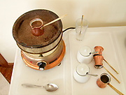 Greece, slow cooking Greek Coffee on an electric plate In other parts of the world it is known as Turkish Coffee