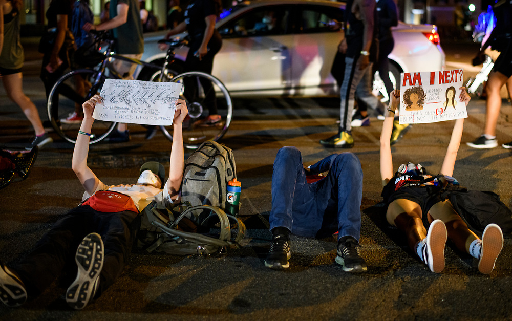 Protesters lay down on the hot pavement in protest. Thousands of Black Lives Matter Protesters march from multiple locations and descended onto the newly name Black Lives Matter plaza on 16th and H Street to protest of the killing of George Floyd in police custody, on Saturday, June 6, 2020.
