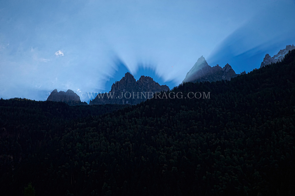 Sun rays at sunrise over the French Alps - Chamonix, France
