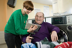 Man and woman using digital tablet, smiling