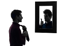 man in front of his mirror man in front of his mirror in shadow white background
