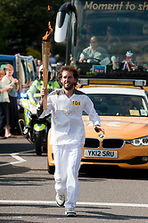 Olympic Torch reaches Sheffield Chapeltown/Ecclesfield/Parson Cross leg.<br /> Still on Ecclesfield Road Francisco De Antonio Anton Runner 104 head for ecclesfield School<br /> 25 June 2012.Image © Paul David Drabble