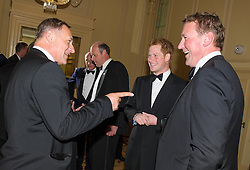 David Hempleman-Adams (left), OBE explorer with Prince Harry and Matthew Pinsent CBE<br /> Prince Harry, Patron of the Walking With The Wounded South Pole Allied Challenge, attends the charity's Crystal Ball at the Grosvenor House Hotel, central London.<br /> The event hosted by Ben Fogle, with music Ellie Goulding and The Stereophonics. Also present were Olympian Matthew Pinsent CBE and Team Glenfiddich. The team of wounded service personnel will accompany the Prince on an expedition to the South Pole later this year, London,<br /> Thursday, 30th May 2013<br /> Picture by Anthony Upton / i-Images