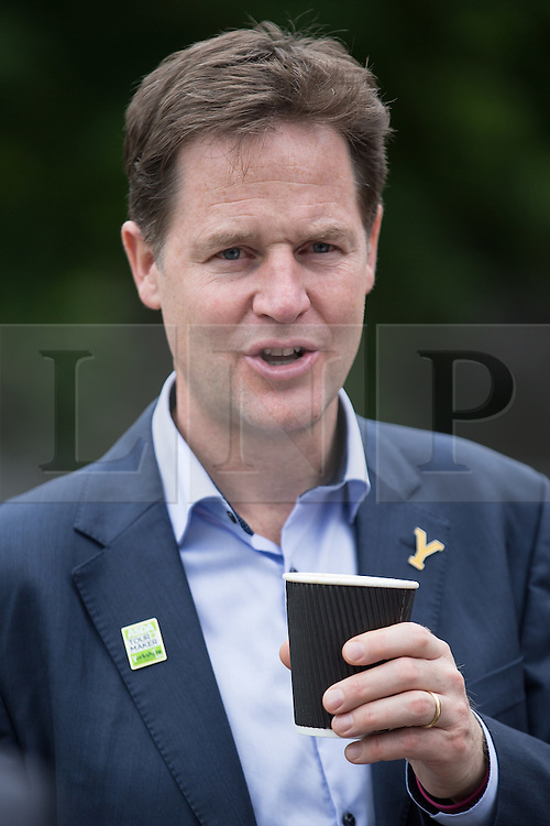 """© Licensed to London News Pictures . 03/07/2014 . Leeds , UK . The Deputy Prime Minister , NICK CLEGG MP , during a coffee break outside the West Yorkshire Playhouse in Leeds today (Thursday 3rd July 2014) . The Liberal Democrat leader and MP for Sheffield Hallam meets cast and crew of production of Maxine Peake's """" Beryl """" based on the life of Beryl Burton , pioneering woman cyclist . Photo credit : Joel Goodman/LNP"""
