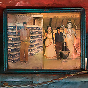 Pepsi and deity. Family portraits. In the Himalaya.