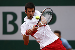 May 30, 2018 - Paris, Ile-de-France, France - Novak Djokovic of Serbia returns the ball to Jaume Munar of Spain during the second round at Roland Garros Grand Slam Tournament - Day 4 on May 30, 2018 in Paris, France. (Credit Image: © Mehdi Taamallah/NurPhoto via ZUMA Press)