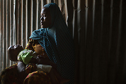 Aisha, 17, comforts her 8-month-old son Mohammed, born of a Boko Haram fighter in Maiduguri, Nigeria. Five girls from her family were taken by the militant Islamist group, which began it's insurgency against the Nigerian government in 2009. The terrorist group drew global outrage after abducting more than 270 schoolgirls from the town of Chibok. Many of the girls were forced into marriage and motherhood. The Borno State National Emergency Agency estimates tens of thousands more women and girls have also been kidnapped by militants in less-publicized attacks. In armed conflicts, child marriage is increasingly used as a weapon of war, forcing girls to give birth give birth to the next germination of fighters. Thousands of girls remain missing in Nigeria with little help of rescue. Those who manage to escape struggle with little support to rebuild their lives.