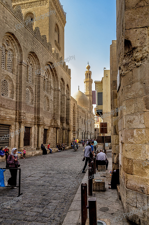 An iconic section of Muizz Street known as Bayn al-Qasrayn, featuring the famous Complex of Sultan Qalawun, and behind it the Mosque-Madrassa of Sultan Barquq.