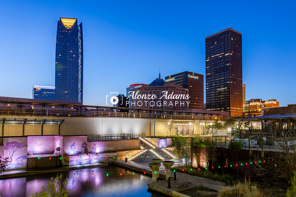 A view of downtown Oklahoma City from Bricktown at dusk on Sunday, April 5, 2020. Photo copyright © 2020 Alonzo J. Adams.