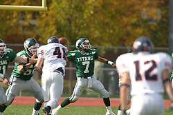 22 October 2005: Titan QB Tom Kudyba releases from the pocket. The Illinois Wesleyan Titans posted a 23 - 14 home win by squeeking past the Thunder of Wheaton College at Wilder Field (the 5th oldest collegiate field in the US) on the campus of Illinois Wesleyan University in Bloomington IL