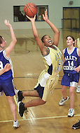TOM BUSHEY/The Record<br /><br />Newburgh Free Academy's Oneisha Staples, center, takes a shot between Valley Central's Megan Quinn, left, and Sharon DiMarco, right, during a Section 9 Class A semifinal game last night at Mount Saint Mary College in Newburgh.<br /><br />March 1, 2001.