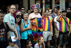 © Licensed to London News Pictures . 24/08/2019. Manchester, UK. Crowds watching . The 2019 Manchester Gay Pride parade through the city centre , with a Space and Science Fiction theme . Manchester's Gay Pride festival , which is the largest of its type in Europe , celebrates LGBTQ+ life . Photo credit: Joel Goodman/LNP