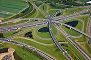 Nederland, Zuid-Holland, Ridderkerk, 23-05-2011; Knooppunt Ridderkerk, verkeersknooppunt A15 / A16, bijgenaamd 'Ridderster'. Klaverblad met opritten, afritten en fly-overs. De waterpartijen zijn kunstmatige aangelegd en kunnen dienen als bluswater ingeval calamiteiten..Ridderkerk junction, junction A15 / A16, nicknamed 'Ridder star'.  Cloverleaf type junction, with ramps, exit ramps and flyovers. The ponds are man-made and the water can be used for  firefighting in case of emergencies..luchtfoto (toeslag), aerial photo (additional fee required).copyright foto/photo Siebe Swart