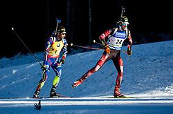 Martin Fourcade (FRA) and Dominik Landertinger (AUT)  during Men 15 km Mass Start at day 4 of IBU Biathlon World Cup 2015/16 Pokljuka, on December 20, 2015 in Rudno polje, Pokljuka, Slovenia. Photo by Vid Ponikvar / Sportida