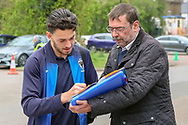 AFC Wimbledon defender Will Nightingale (5) signing autographs during the EFL Sky Bet League 1 match between AFC Wimbledon and Accrington Stanley at the Cherry Red Records Stadium, Kingston, England on 6 April 2019.