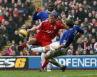 Photo: Paul Thomas.<br /> Liverpool v Everton. The Barclays Premiership. 03/02/2007.<br /> <br /> Alan Stubbs (R) of Everton just gets in before Liverpool striker Dirk Kuyt can shoot for goal.
