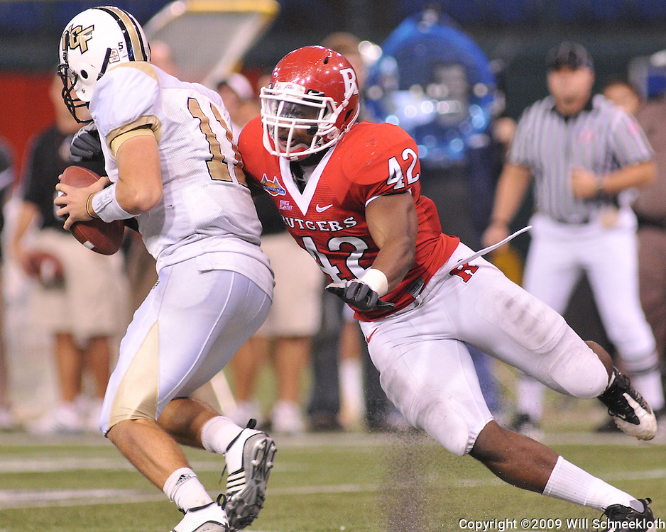 Dec 20, 2009; St. Petersburg, Fla., USA; Rutgers linebacker Steve Beauharnais (42) sacks UCF quarterback Brett Hodges (11) during NCAA Football action in Rutgers' 45-24 victory over Central Florida in the St. Petersburg Bowl at Tropicana Field.