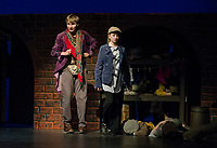 "Topher Weimann as Fagin and Kathryn Osburn as Oliver during dress rehearsal for Gilford High School's musical production ""Oliver"" Tuesday evening.  (Karen Bobotas/for the Laconia Daily Sun)"
