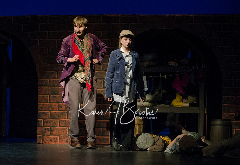 """Topher Weimann as Fagin and Kathryn Osburn as Oliver during dress rehearsal for Gilford High School's musical production """"Oliver"""" Tuesday evening.  (Karen Bobotas/for the Laconia Daily Sun)"""