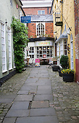 Shops in cobbled street of old alleyway, Marlborough, Wiltshire, England