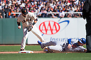 San Francisco Giants shortstop Brandon Crawford (35) picks up a ball at second base against the Los Angeles Dodgers at AT&T Park in San Francisco, Calif., on October 1, 2016. (Stan Olszewski/Special to S.F. Examiner)