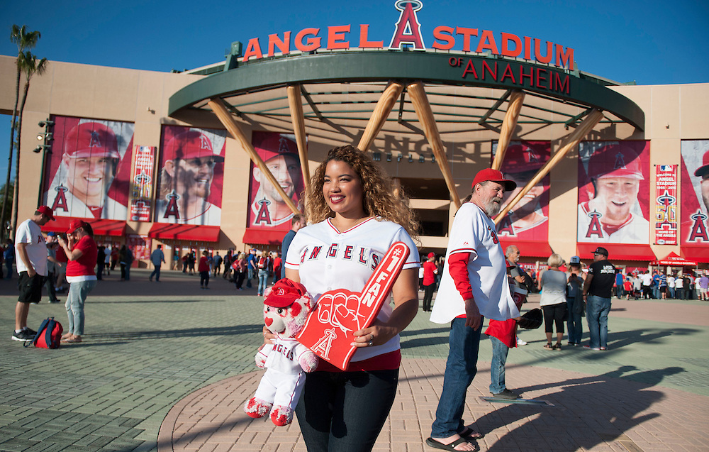 Jannette Mendoza, 27, of Loma Linda, poses for a photo before the Angels' home opener Monday at Angel Stadium.<br /> <br /> ///ADDITIONAL INFO:   <br /> <br /> angels.0405.kjs  ---  Photo by KEVIN SULLIVAN / Orange County Register  --  4/4/16<br /> <br /> The Los Angeles Angels take on the Chicago Cubs during their 2016 home opener Monday at Angel Stadium.<br /> <br /> <br />  4/4/16