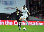 Lucy Bronze of England Women is challenged by Alexandra Popp of Germany Women<br /> - Womens International Football - England vs Germany - Wembley Stadium - London, England - 23rdNovember 2014  - Picture Robin Parker/Sportimage
