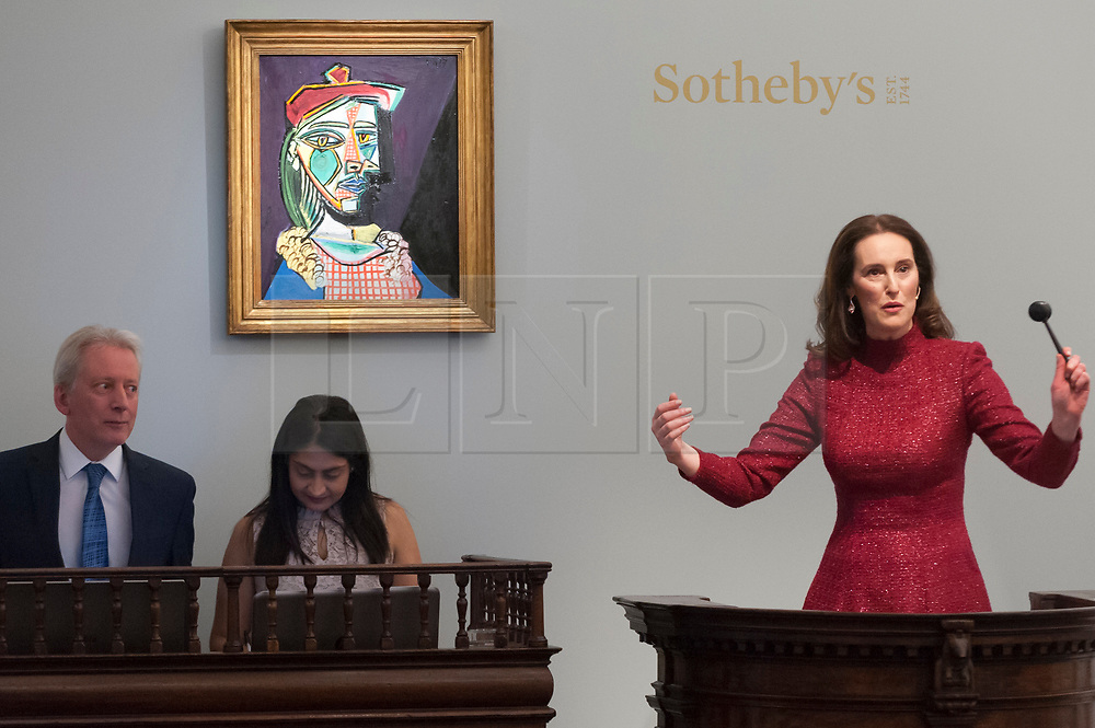 © Licensed to London News Pictures. 28/02/2018. LONDON, UK. ''Femme Au Béret Et À La Robe Quadrillée (Marie-Thérèse Walter)'' by Pablo Picasso, (Est. in excess of $50m) sold for a hammer price of GBP44m ($61.1m) at the evening sale of Modern, Surrealist and Contemporary art at Sotheby's in New Bond Street.  Photo credit: Stephen Chung/LNP
